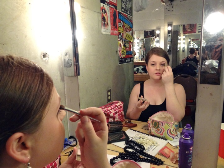 Emma puts on make-up and gives you the finger.